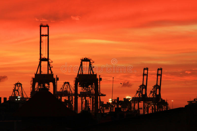 Dusk of Harbor. And the crane royalty free stock photo