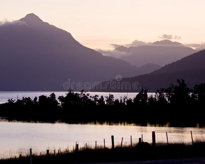 Dusk, Mountains and Water stock photos
