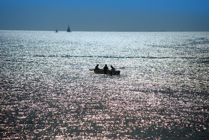 Download Dusk over sea, fishermen stock photo. Image of black - 11650388