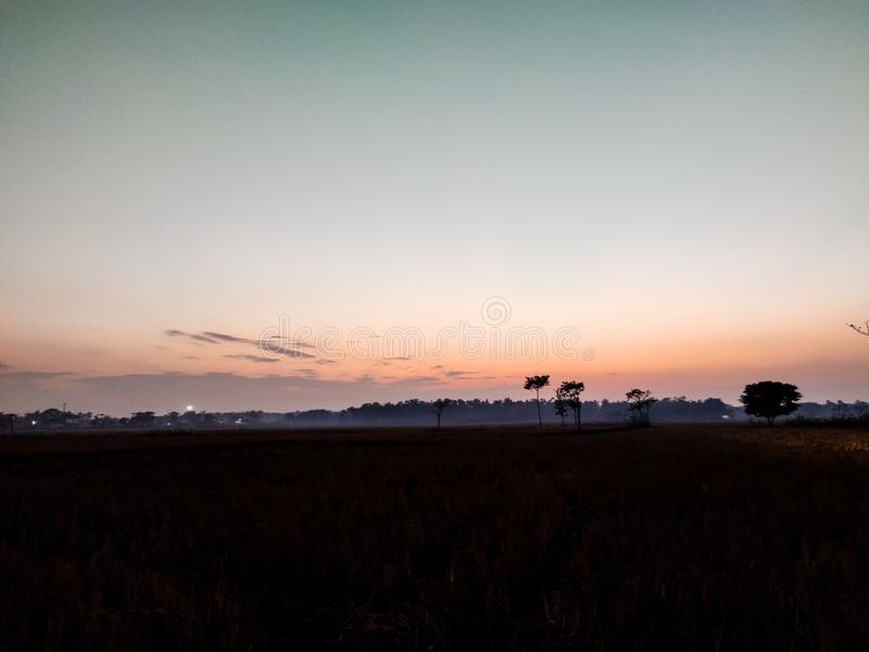 Dusk time during sun set sky colour turns into red colour. Dusk time during sun set sky colour turns into red royalty free stock image