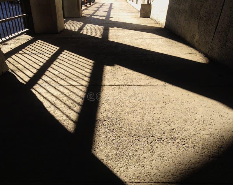 Dusky shadow under the bridge. Long dusky shadow under a bridge during summer day stock photos