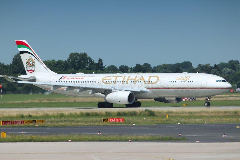 Etihad Airways. DUSSELDORF, GERMANY - JULY 8, 2013: Airbus A330 of Etihad Airways in Dusseldorf Airport, Germany. Etihad carried 14.8 million passengers in 2015 royalty free stock image