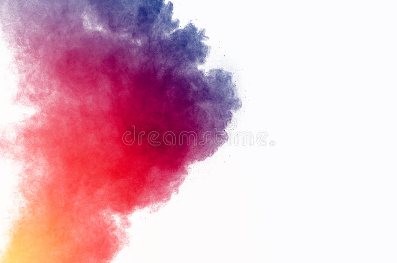 Dust explosion. Abstract colored powder on white background. Frozen abstract movement of dust explosion multiple colors on white background. Stop the movement of stock photography