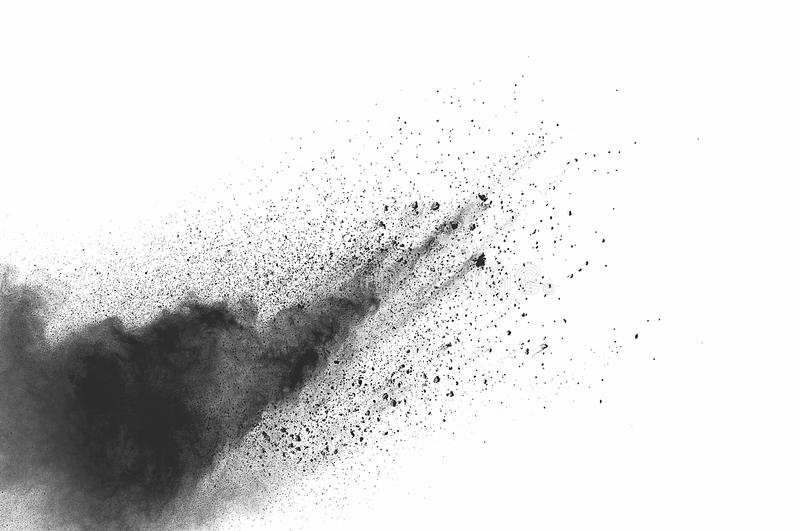 Dust explosion. Freeze motion of black dust explosion on white background. Stopping the movement of dark powder on white background. Explosive powder black on stock images