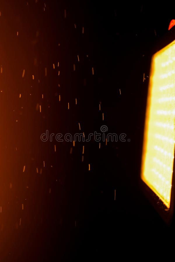 Dust Fire Beam Light Orange. The photo shows a light source and dust that looks like fire. Very beautiful and unusual stock photos