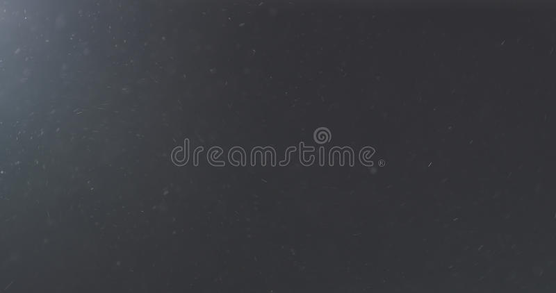 Dust particles fast moving over black background from left corner stock image