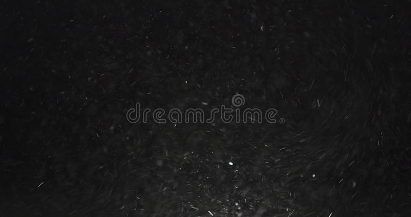 Dust particles fast moving over black background from right royalty free stock photography