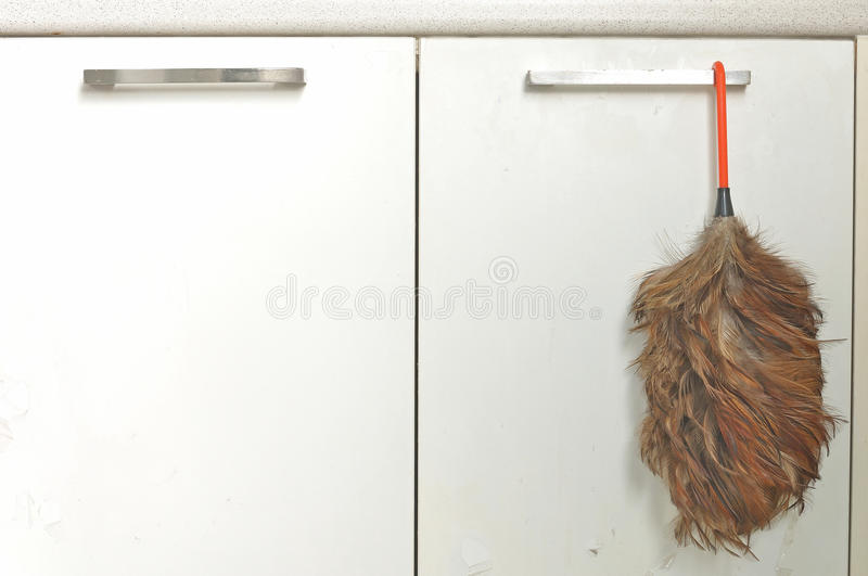 Duster feather. Old duster feather for housekeeper royalty free stock photography