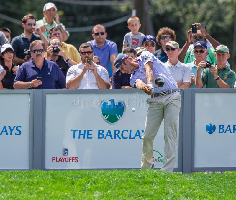 Dustin Johnson at the 2012 Barclays. FARMINGDALE, NY - AUGUST 21: Long Hitting Dustin Johnson hits a drive at Bethpage Black during the Barclays on August 21 royalty free stock photography