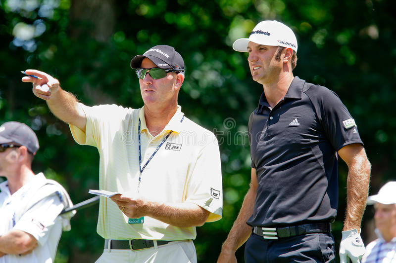 Dustin Johnson and caddy Joe LaCava. BETHESDA, MD - JUNE 15: Joe LaCava, hired by Tiger Woods to be his full-time caddy, works with Dustin Johnson at stock photography