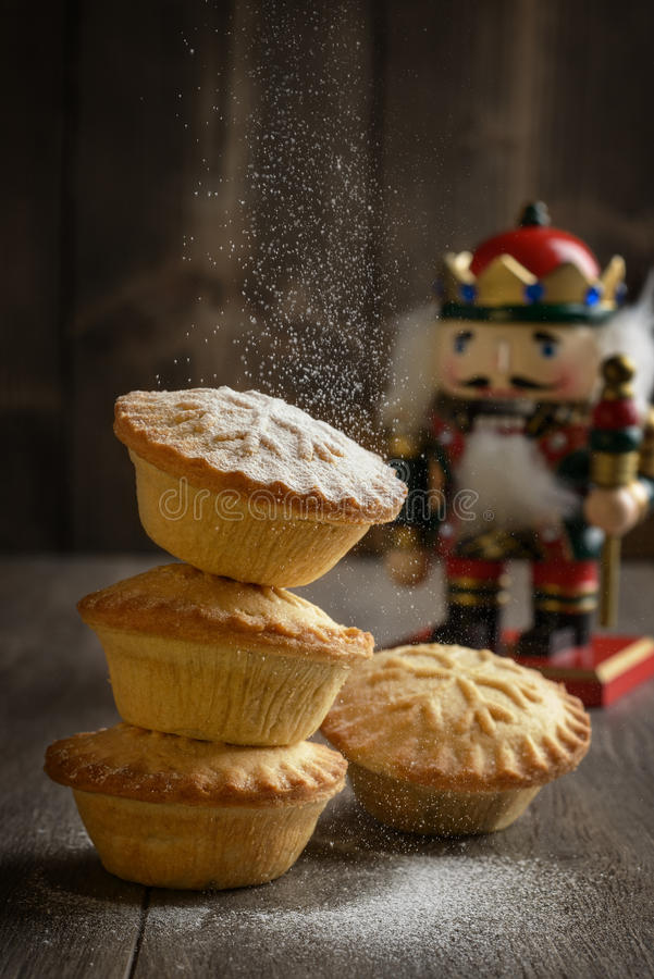 Dusting Mince Pies. With icing sugar for Christmas stock image