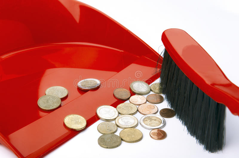 Dustpan, brush and eurocent royalty free stock photos