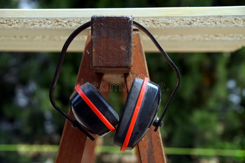 Ear Defenders hanging on working trestle royalty free stock photos
