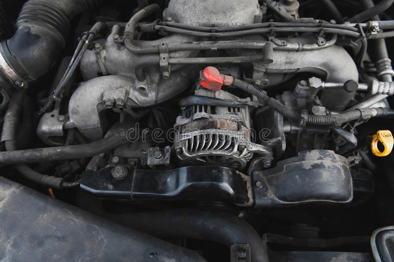 Dusty boxer engine and generator under the hood. royalty free stock photos