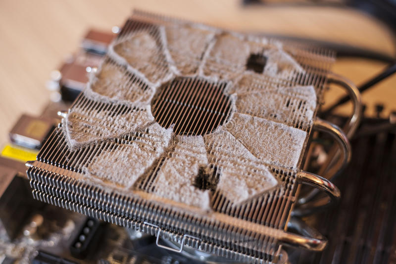Dusty CPU cooler. A CPU cooler with a nice accumulation of dust below where the fan sits royalty free stock images