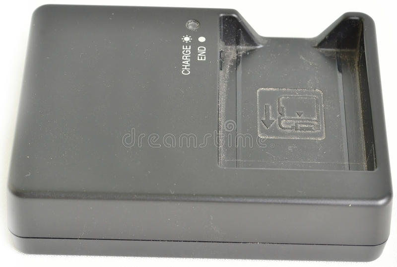 Download Dusty DSLR Battery charger stock photo. Image of isolated - 26998890