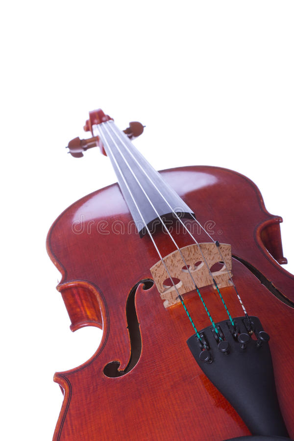 Dusty old violin. Old violin photographed in perspective isolated on white background stock images