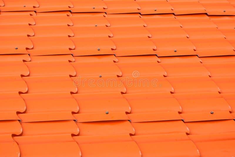 Dusty Orange Metal Sheet Roof-Achtergrondtextuur royalty-vrije stock foto's