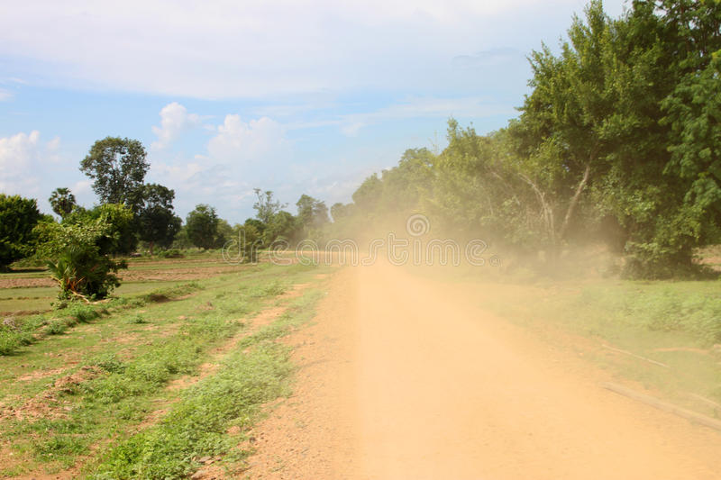 Dusty road. To Lee Phee waterfalls on Don Khon Island, Lao PDR stock photo