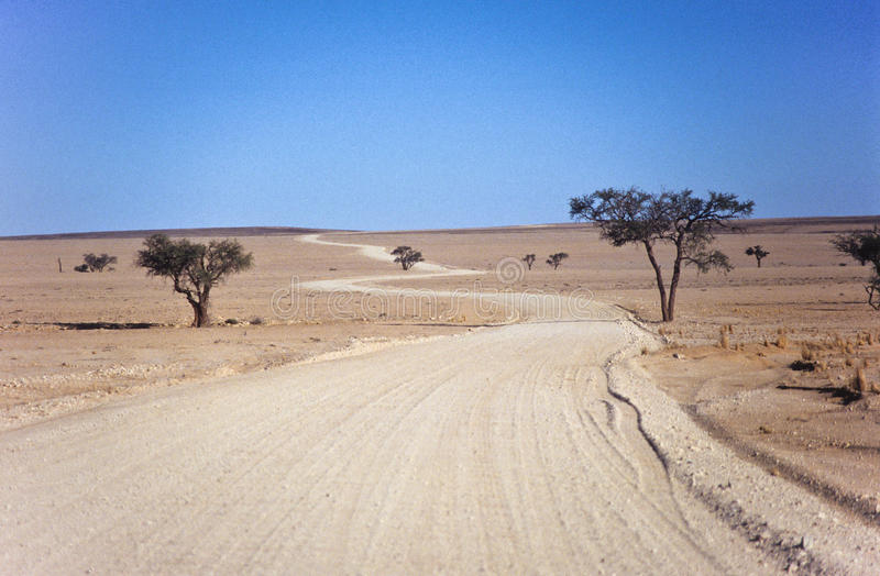 Download Dusty road stock photo. Image of winding, desert, landscape - 27641708