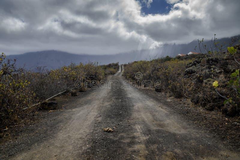 Dusty road in el golfo valley. El hierro, canary islands, spain stock photography