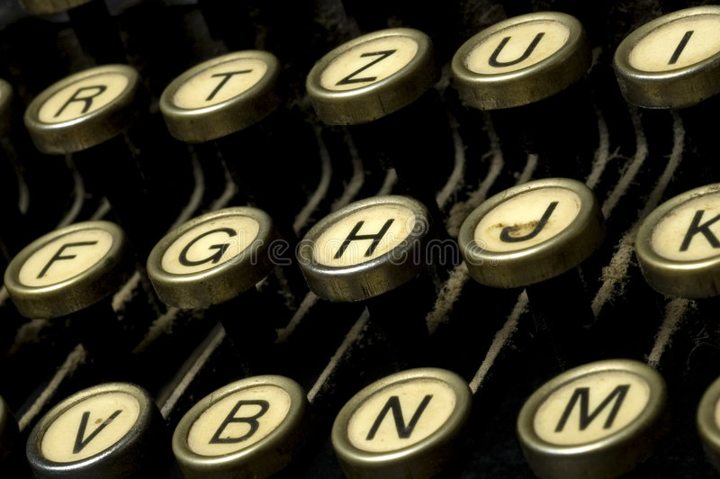 Dusty typewriter machine. Closeup of old typewriter machine royalty free stock photo