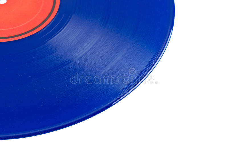Dusty vinyl record. With red label isolated on white background. Shallow depth of field royalty free stock photo