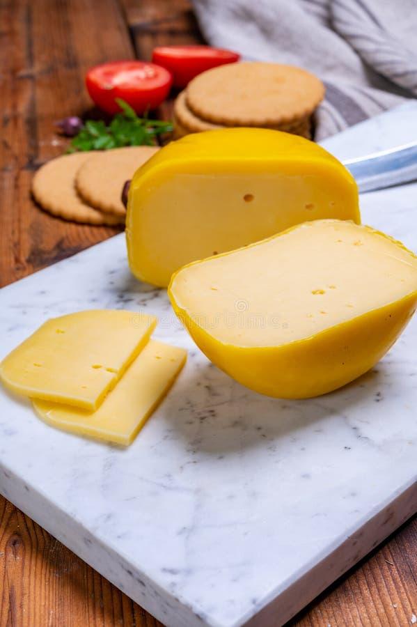 Dutch Baby Gouda Cheese In Yellow Wax Stock Photo - Image ...
