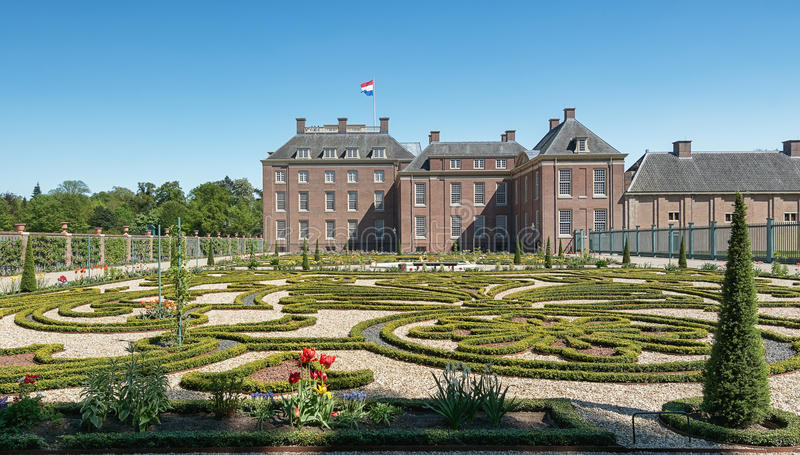 Dutch baroque garden of The Loo Palace in Apeldoorn. Apeldoorn, The Netherlands, May 8, 2016: Dutch baroque garden of The Loo Palace , a former royal palace and royalty free stock images