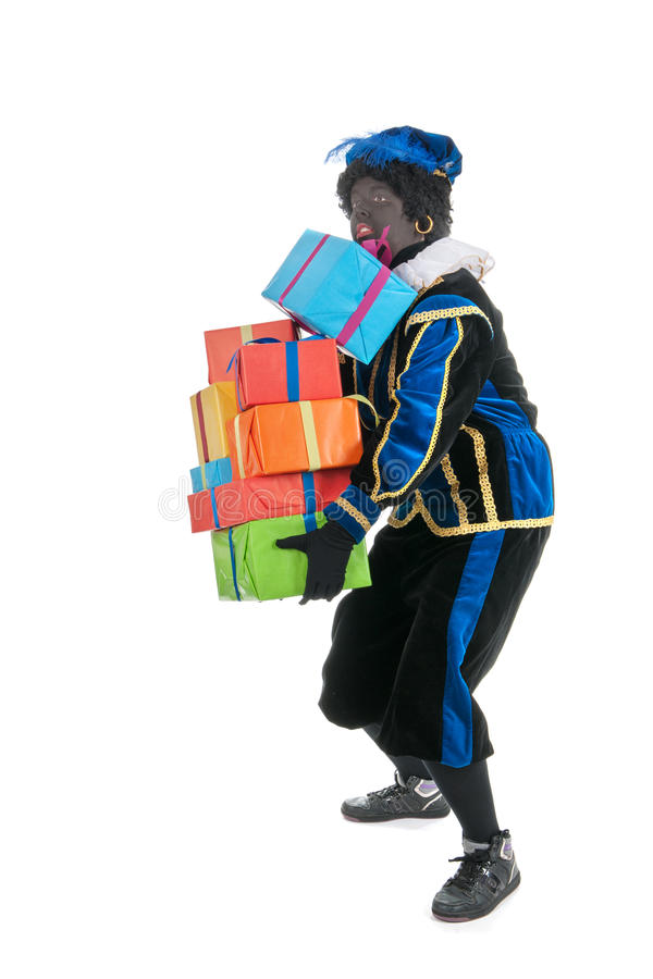 Dutch black pete carrying many presents stock photo