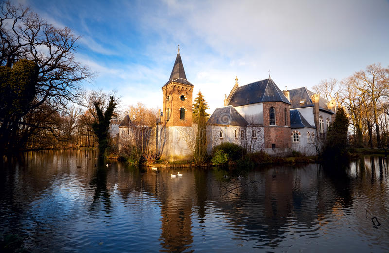 Dutch castle in Boxtel. Castle in the middle of the lake in Boxtel, Netherlands stock photo
