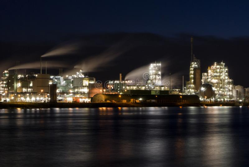 Chemical factory along the river Merwede. Dutch Chemical plant in Dordrecht on the shore of the river Merwede stock photos