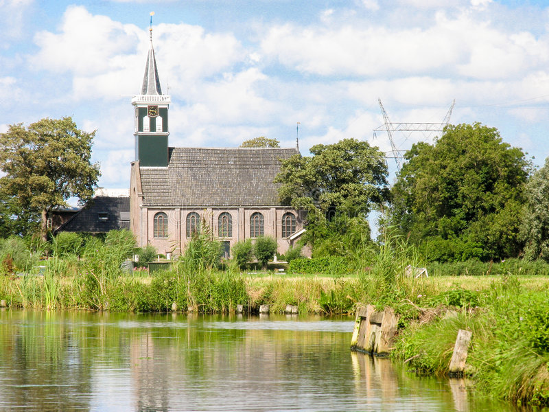 Dutch church from the water royalty free stock photography