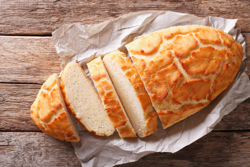Dutch crunch bread sliced close-up. horizontal top view, rustic royalty free stock images