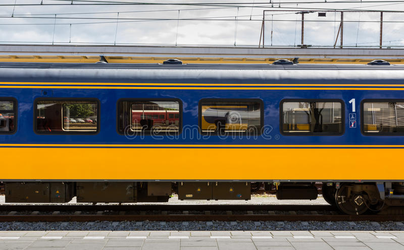 Dutch first class train car. Waiting at the station stock image