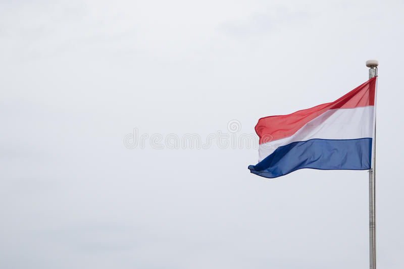 Dutch flag flying in the wind. With room for text stock photo