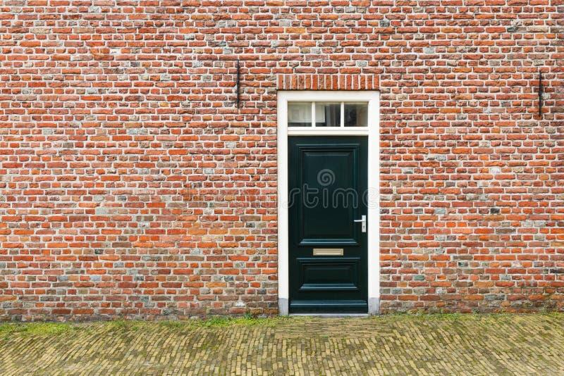 Dutch front door. In orange brick facade stock images
