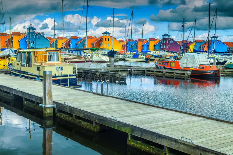 Dutch harbor with traditional colorful houses on water, Groningen, Netherlands. Fantastic travel and touristic destination, famous harbor with luxury boats and royalty free stock photos