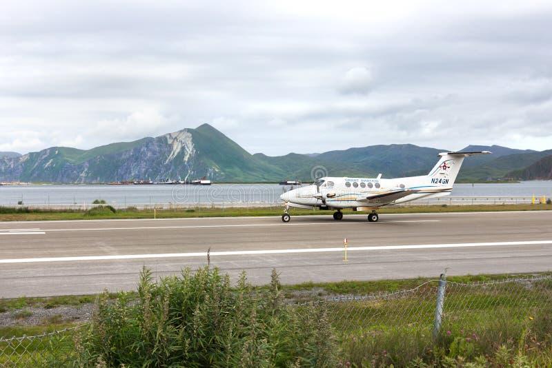 A Beeach King Air 200 at Tom Masden airport, Unalaska. Dutch Harbor, Unalaska, Alaska, USA - August 14th, 2017: A Beech King Air 200 of Grant Aviation ready to royalty free stock image