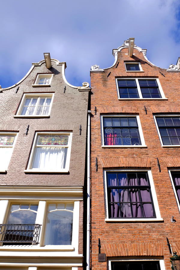Dutch house fronts. A detail of the gable ends of dutch canal side houses in Amsterdam stock photography