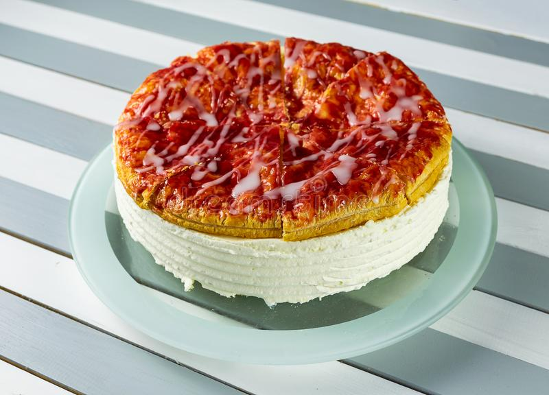 A dutch kirsch cream pie on a round pie plate royalty free stock photos
