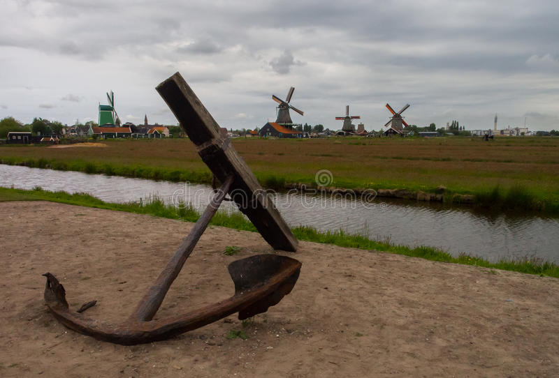 Dutch landscape with anchor, canals and windmills royalty free stock photos