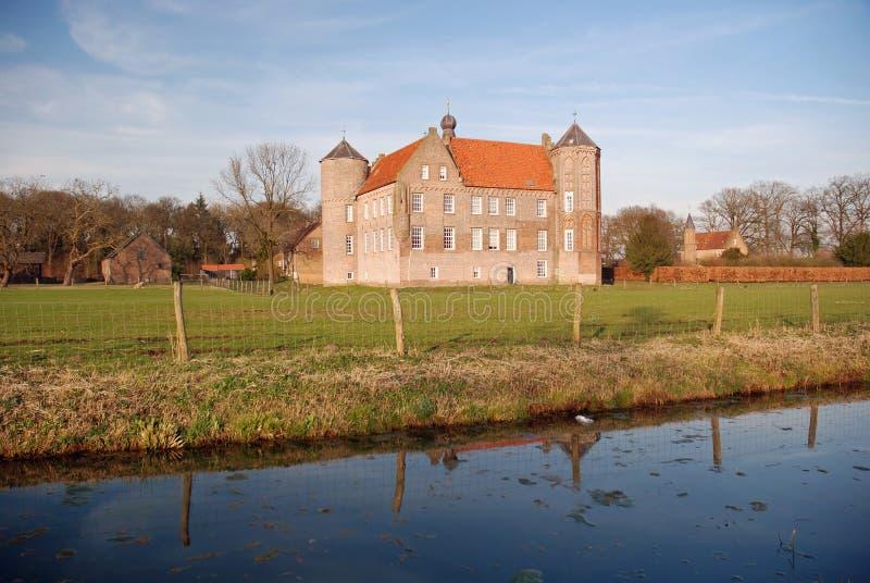 Dutch landscape- Castle Croy and farms- Laarbeek. Dutch landscape with moat around castle Croy and farms - Laarbeek - Noord-Brabant - Netherlands royalty free stock images