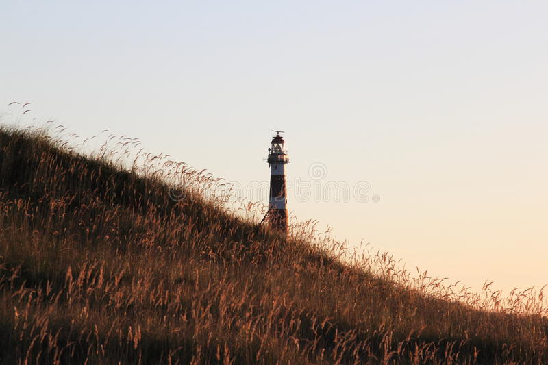 Dutch lighthouse Bornrif in Ameland dunes near Hollum royalty free stock photography