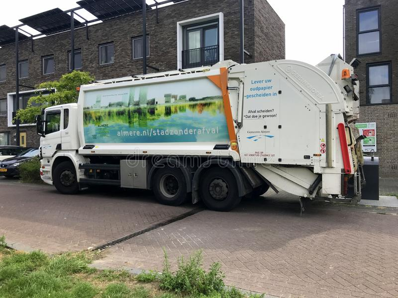 Dutch MAN garbage truck. Almere, Flevoland, the Netherlands - August 14, 2019: MAN garbage truck for the city of Almere, parked by the side of the road. Nobody royalty free stock photography