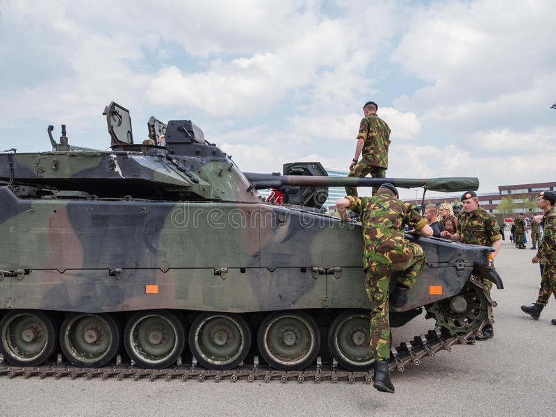 Dutch military tank. ALMERE, NETHERLANDS - 23 APRIL 2014: Dutch military armored fighting vehicle on display during the National Army Day in Almere can be stock images