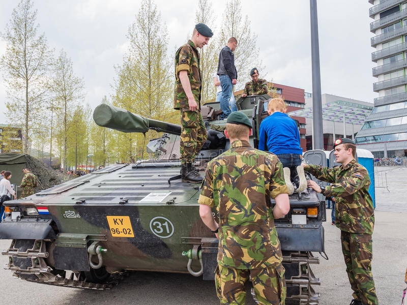 Dutch military tank. ALMERE, NETHERLANDS - 23 APRIL 2014: Dutch military armored fighting vehicle on display during the National Army Day in Almere can be stock image