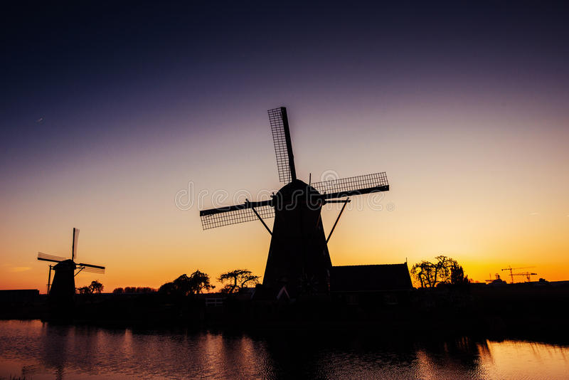 Dutch mill by night Holland Netherlands. Beauty world.  royalty free stock photo