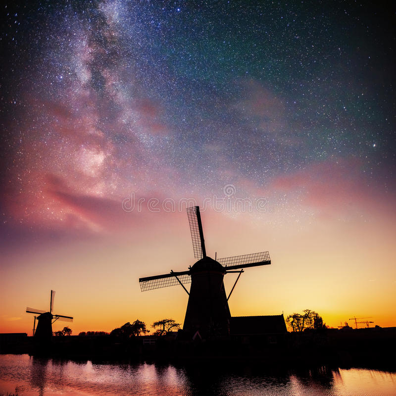 Dutch mill at night. Starry sky. Holland. Netherlands. Dutch mill at night. Starry sky Holland Netherlands royalty free stock photo