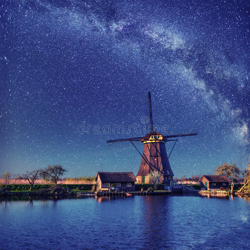 Dutch mill at night. Starry sky. Holland. Netherlands. Dutch mill at night. Starry sky. Holland Netherlands royalty free stock images